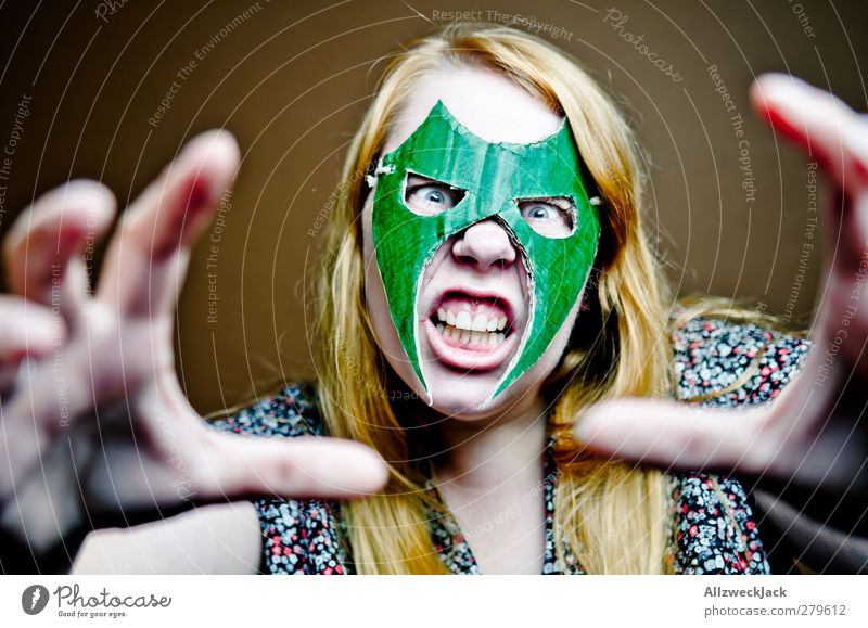 Human being Youth (Young adults) Green Adults Feminine Young woman Brown 18 - 30 years Exceptional Crazy Threat Mask Carnival Athletic Anger Force