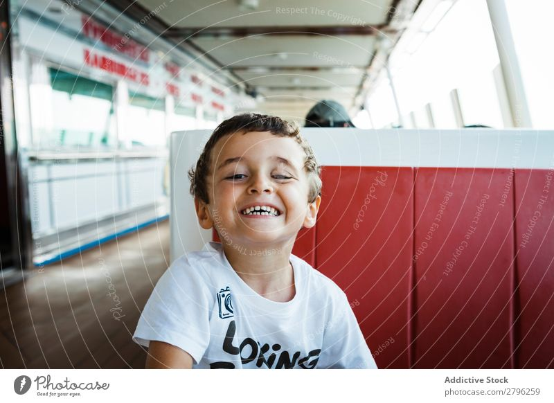 Boy smiling on seat Boy (child) Face Child Funny Seat Sit Table Man Joy Infancy Expression Happiness Lifestyle Gesture brunet Crazy Uniqueness Sadness Fatigue