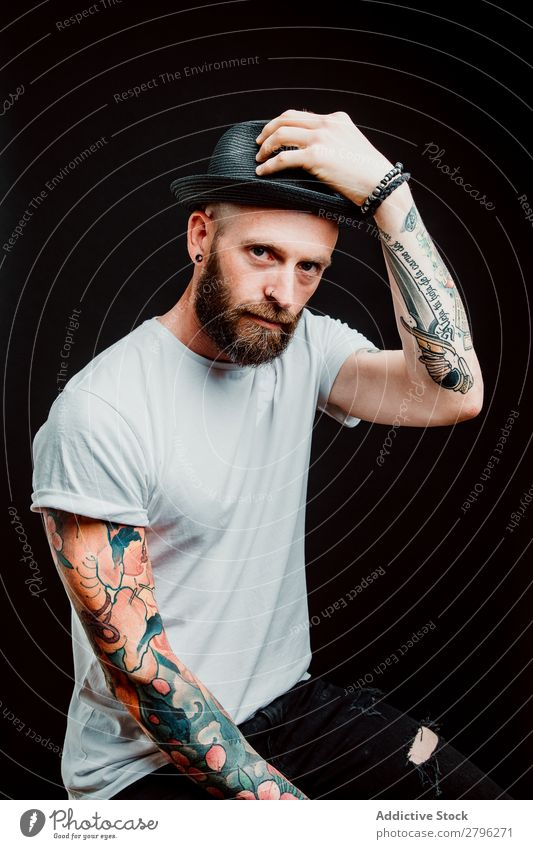 Smiling young guy in hat Man Hipster Tattoo Youth (Young adults) Guy bearded Hat T-shirt Hand Cheerful Easygoing Happy handsome Cool (slang) Style Hip & trendy