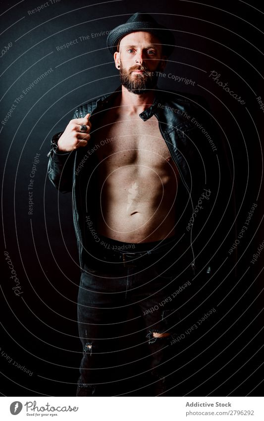 Young shirtless bearded guy in leather jacket Man Leather jacket Hipster Youth (Young adults) Adjust Hat Guy handsome Cool (slang) Style Easygoing Studio shot