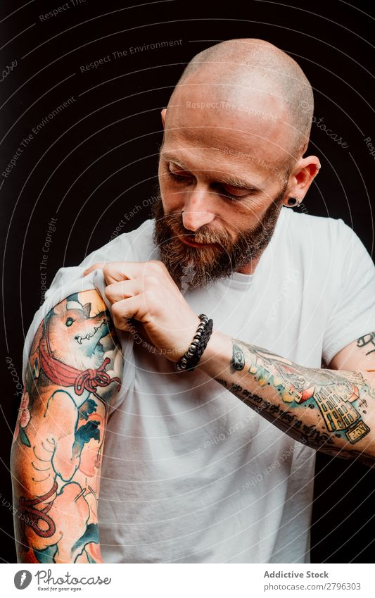 Young bald guy showing tattoos Man Tattoo Hipster Bald or shaved head Youth (Young adults) Guy bearded T-shirt Hand hairless Indicate Easygoing handsome Art
