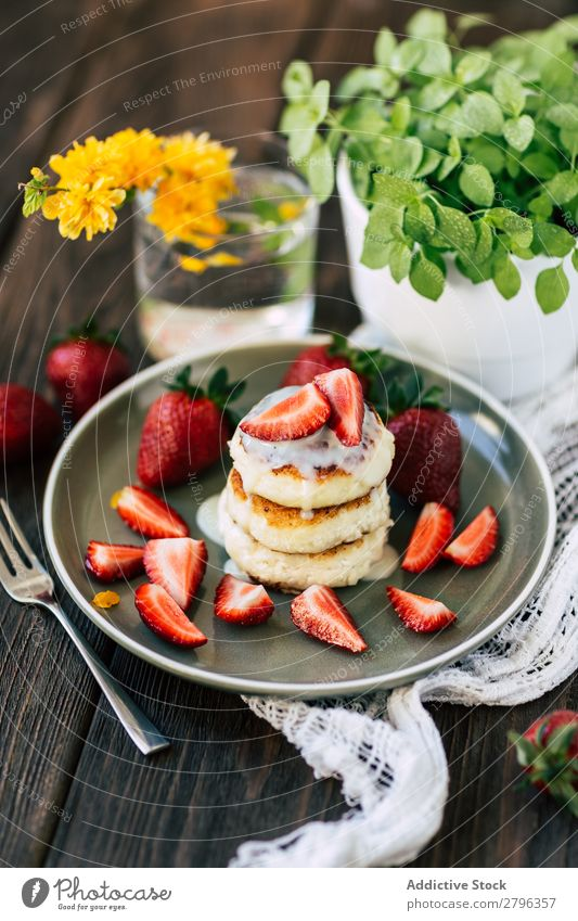 Tasty pancakes with strawberries Pancake Rocks Strawberry Plate Table Flower Plant Pot Food Breakfast Dessert Sweet Delicious Meal Stack Gourmet Morning Snack