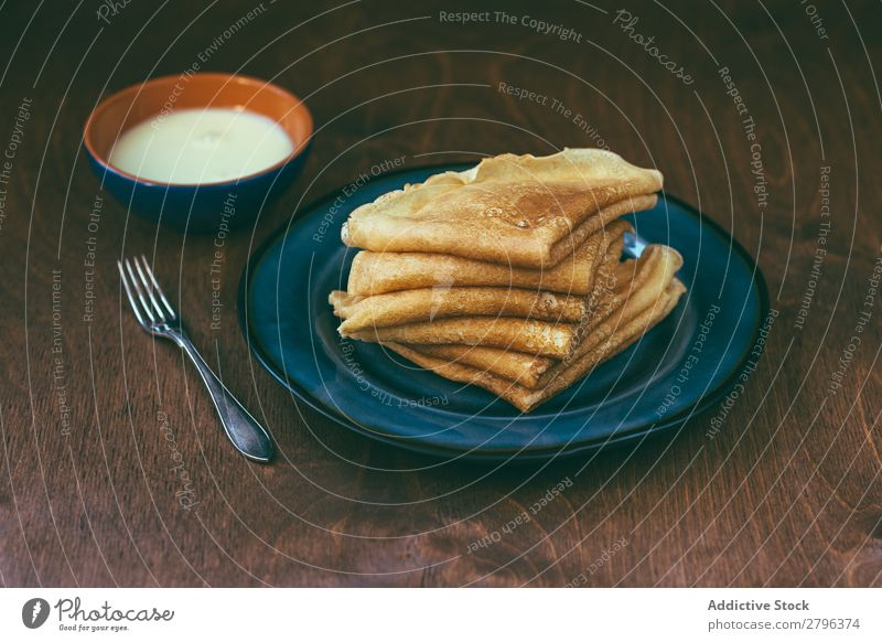 Sauce near stack of blini Stack Breakfast Russian Tradition Fork Plate Bowl Cream Pancake Rocks Crêpe Home-made Frying Baked goods Tasty Delicious yummy Fresh
