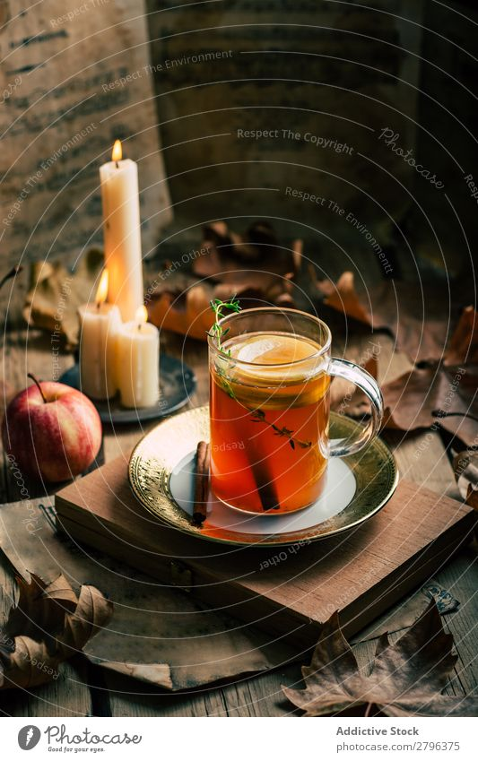 Tea near candles and apple Apple Candle Leaf Autumn Cup Flame Hot Drinking Warmth Beverage Lemon Aromatic Fire decor Design Vintage Retro Shabby Seasons Rustic
