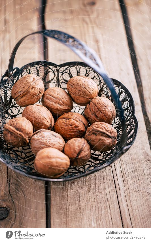 Ornamental basket with walnuts Basket Table Metal Healthy Natural Ingredients Snack Organic Tasty Delicious yummy Fresh bunch Heap Collection composition Wood