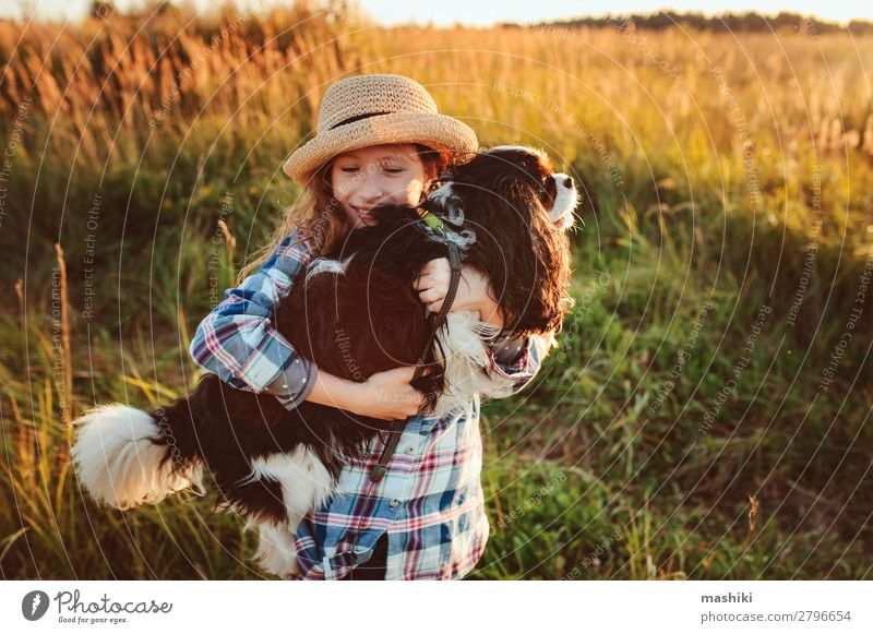 happy child girl enjoying summer vacations with her dog Lifestyle Joy Leisure and hobbies Playing Vacation & Travel Trip Adventure Freedom Expedition Summer