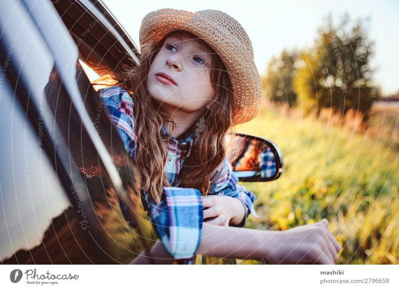 happy child girl looking out the car window Lifestyle Joy Leisure and hobbies Playing Vacation & Travel Trip Adventure Freedom Expedition Summer Hiking Child