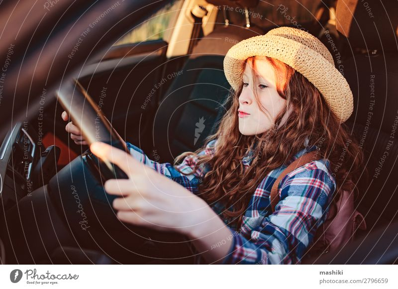 funny child girl playing driver, sitting on front seat in car Lifestyle Joy Happy Leisure and hobbies Playing Vacation & Travel Trip Adventure Freedom