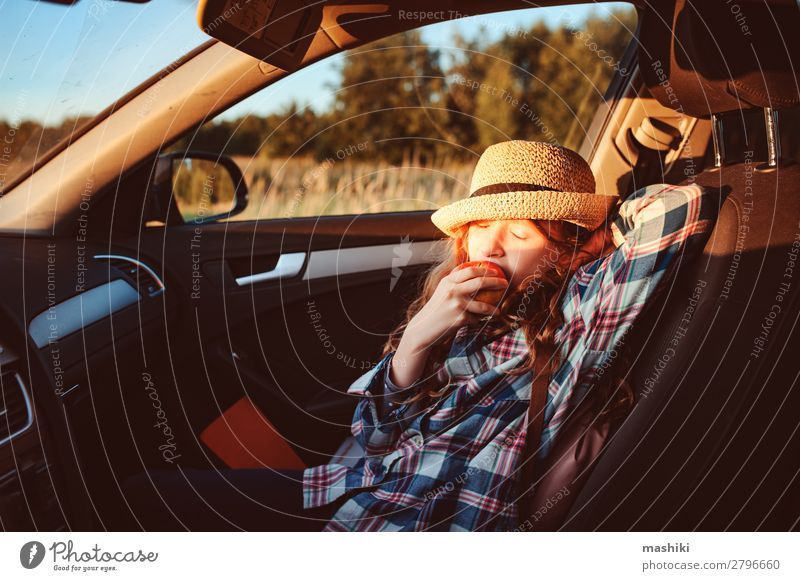 happy child girl eating apple in car. Lifestyle Joy Happy Leisure and hobbies Playing Vacation & Travel Trip Adventure Freedom Expedition Summer Hiking Child