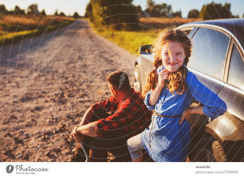 father and daughter changing broken tire Child Man Summer Street Adults Family & Relations School Together Work and employment Car Transport Authentic Parents