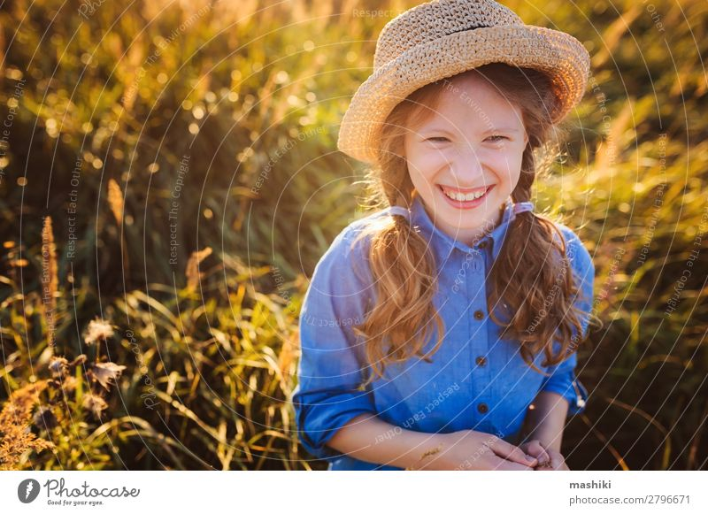 happy kid girl in blue dress and straw walking on summer Lifestyle Joy Happy Relaxation Leisure and hobbies Playing Vacation & Travel Freedom Summer Child