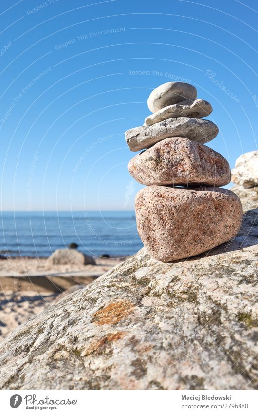 Stack of stones on a beach. Harmonious Contentment Relaxation Meditation Summer Beach Ocean Nature Sky Rock Stone Blue Acceptance Trust Serene Patient Balance