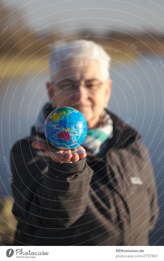 Senior holds a globe Earth Globe 60 years and older Grandmother Female senior Environmental pollution Environmental protection naturally Planet Climate change