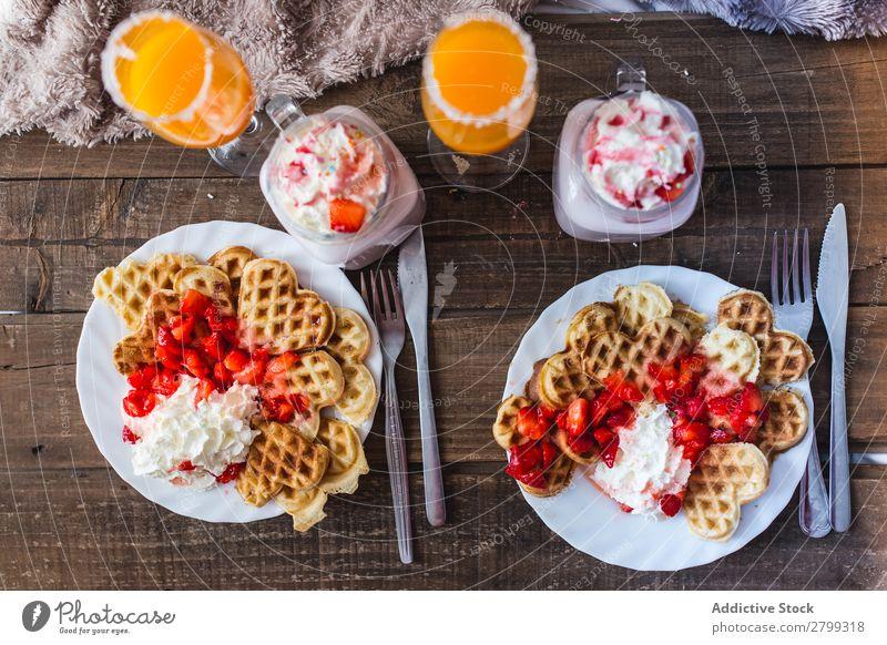 Appetizing waffles with jam and tasty drinks on tray on bed Bed Tray Waffle Drinking appetizing Tasty Berries Jam Plate Juice Milkshake Cream Bedroom Glass