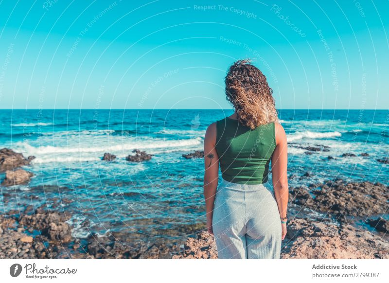 Stylish woman standing near sea Woman Ocean Coast Dream Stand Lifestyle Leisure and hobbies Rest