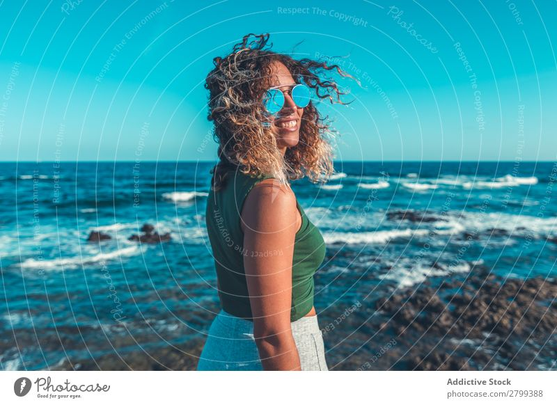 Stylish woman standing near sea Woman Ocean Coast Dream Stand Lifestyle Leisure and hobbies Rest Relaxation Waves Water Style Hip & trendy Easygoing Sunglasses