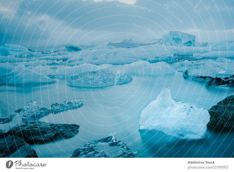 Majestic icebergs in tranquil blue water Iceberg Water Iceland Glacier Ocean North Blue Long exposure Crystal Clear Nature Natural Landscape Peace Beautiful