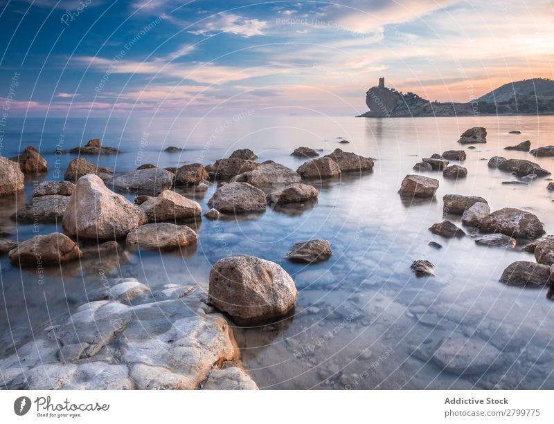 Sundown sky over sea and stony coast Sky Sunset Ocean Coast Stone Evening Nature cala charco alicante Spain Clouds Weather Cloud cover Dusk Twilight Bright Rock