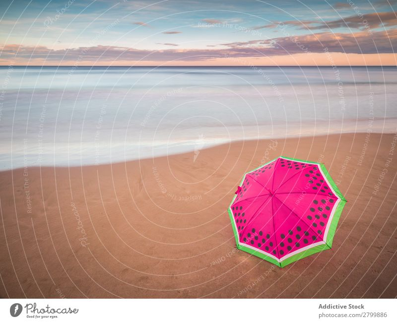 Umbrella on beach near sea Beach Ocean Sunset Evening Sky Clouds Waves Vacation & Travel Coast Sand Trip Tourism Dusk Twilight Water Paradise Resort Sunshade