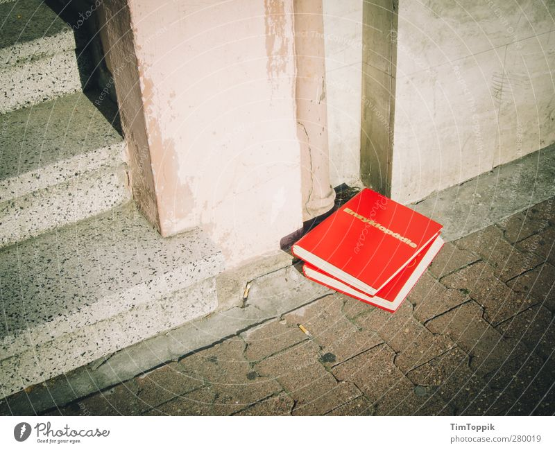Encyclopedia of the Street Town Red Pavement Book Landing House (Residential Structure) Wall (building) Trash Dispose of Paving stone Know Smart Education Study