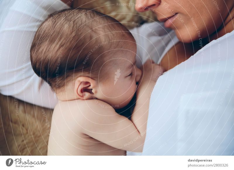 Newborn lying on bed embraced by her mother Lifestyle Elegant Beautiful Child Human being Baby Woman Adults Mother Family & Relations Aircraft Love Embrace