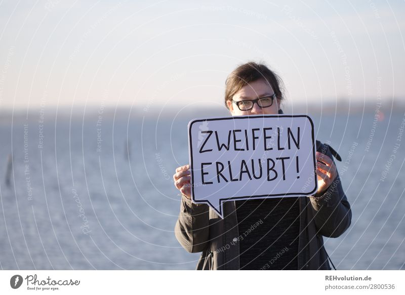 Woman with speech bubble Text Speech bubble To hold on Signage Signs and labeling Characters Adults Feminine communication portrait stop Nature Lake Eyeglasses