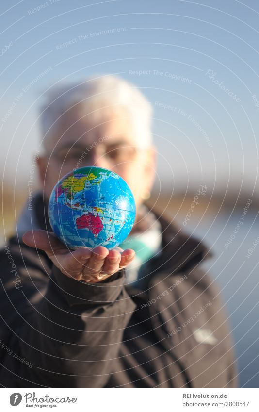 Senior holds a globe Human being Feminine Woman Adults Female senior Grandmother Senior citizen Life 1 60 years and older Environment Nature Sky Climate