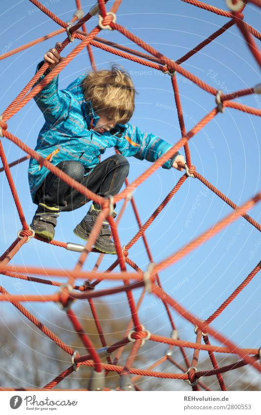 Child climbs on the playground Human being Boy (child) Infancy 1 3 - 8 years Sky Cloudless sky Spring Beautiful weather Playground Movement Playing Authentic