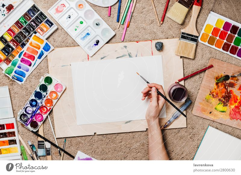 Flatlay with woman's hands holding stationary supplies paint Pencil Conceptual design Artist Board Cactus Carpet Caucasian Colour Multicoloured Craft (trade)