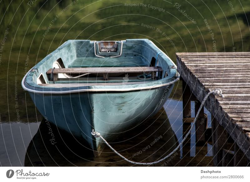 Old Rowing Boat Moored at a Scottish Highland Loch Leisure and hobbies Vacation & Travel Beach Waves Rope Plant Grass Forest Coast Lake Fishing boat Rowboat