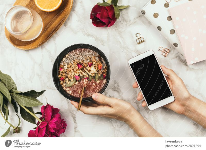 Hands holding smoothie bowl with laptop, peonies and water Breakfast chia pudding Diet Beverage Drinking Woman flat flatlay Flower Food Healthy Eating Cereal