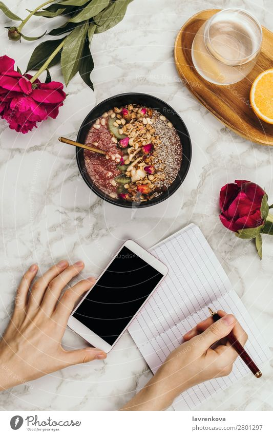 Flatlay of woman's hands holding smoothie bowl with laptop Breakfast chia pudding Diet Beverage Woman flat flatlay Flower Food Healthy Eating Cereal Hand