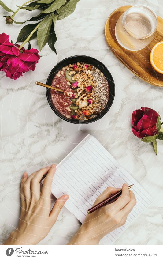 woman's hands with notebook, smartphone and vegan smoothie Organic Ingredients Pen Vantage point Top Marble Snack topping Cereal Flower flatlay Table Peony