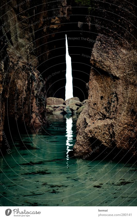 Out of the light (into the dark) Environment Nature Water Summer Rock Bay Ocean Cave Entrance Stone Dark Wet Low water Low tide Shallow Passage Opening