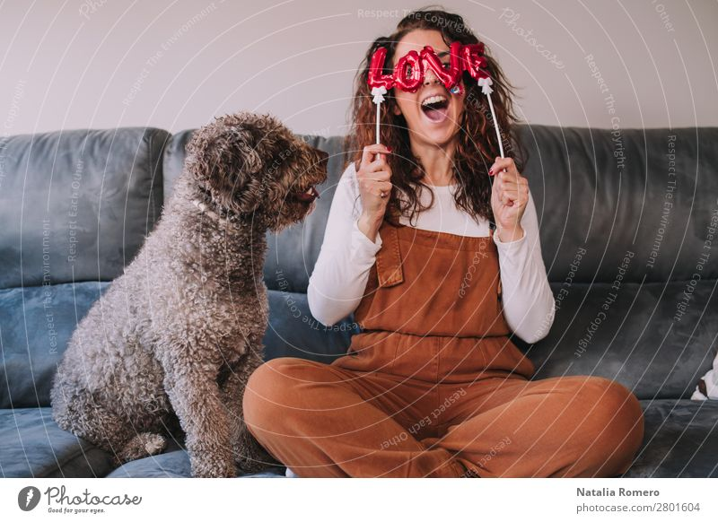 Woman with the word love on her face and her pet Human being Dog Youth (Young adults) Young woman White Red House (Residential Structure) Animal Joy Winter