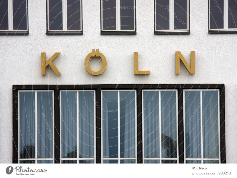 K Ö L N Town Manmade structures Building Architecture Facade Window Yellow Gold Cologne Logo Office building Industrial site Old building Pane Window pane