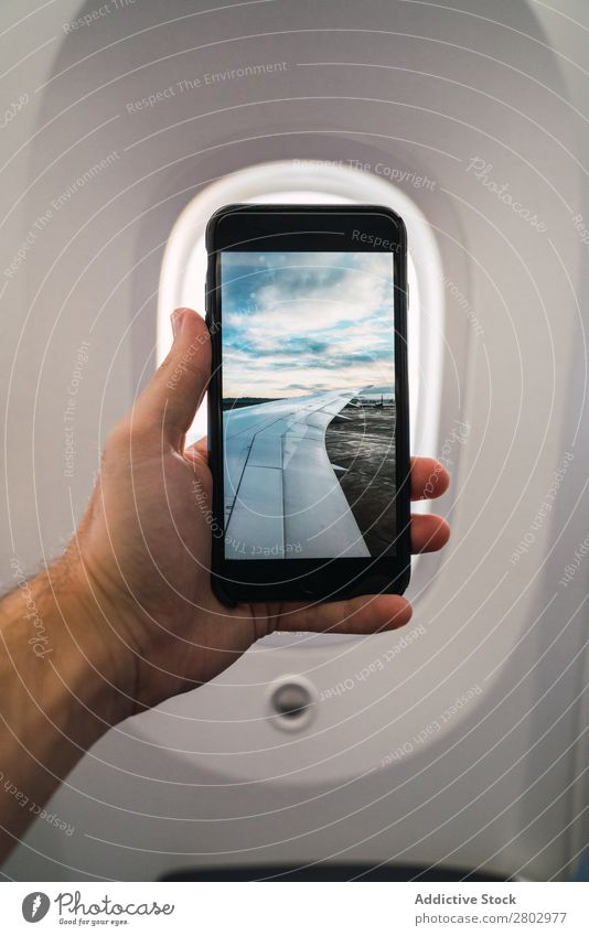 Crop hand showing airport photo inside plane Man PDA Photography Indicate Airport Airplane Story Vacation & Travel Passenger Youth (Young adults) Technology