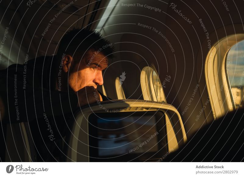 Thoughtful man looking out plane window Man Window Considerate Airplane Story Adults Vacation & Travel Passenger Safety (feeling of) Seat Transport Pensive