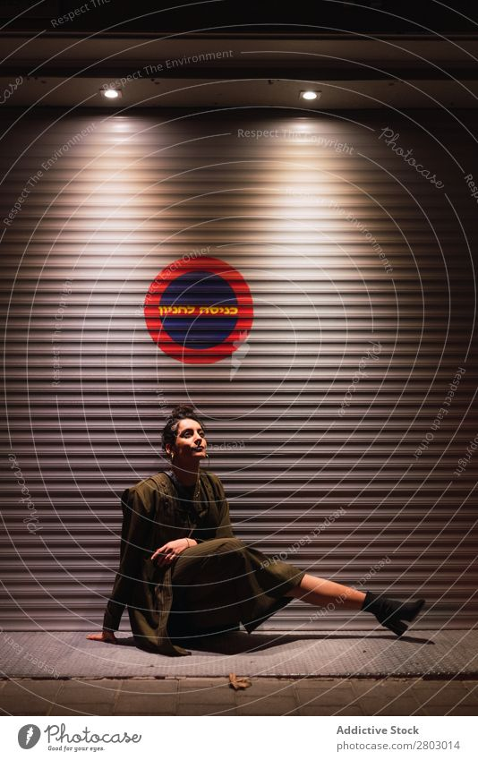 Attractive stylish lady sitting near wall of profiled sheeting Woman Style Hip & trendy Wall (building) Hipster Tel Aviv Israel Night Street Light Posture