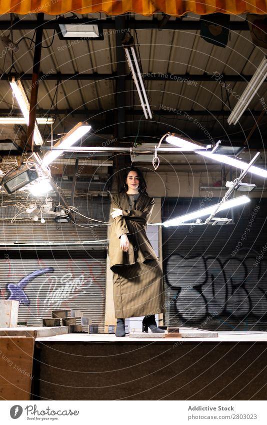 Attractive stylish lady sitting under lamps Woman Style Hip & trendy Wall (building) Hipster Tel Aviv Israel Lamp Graffiti Night Street Illuminate Light Posture