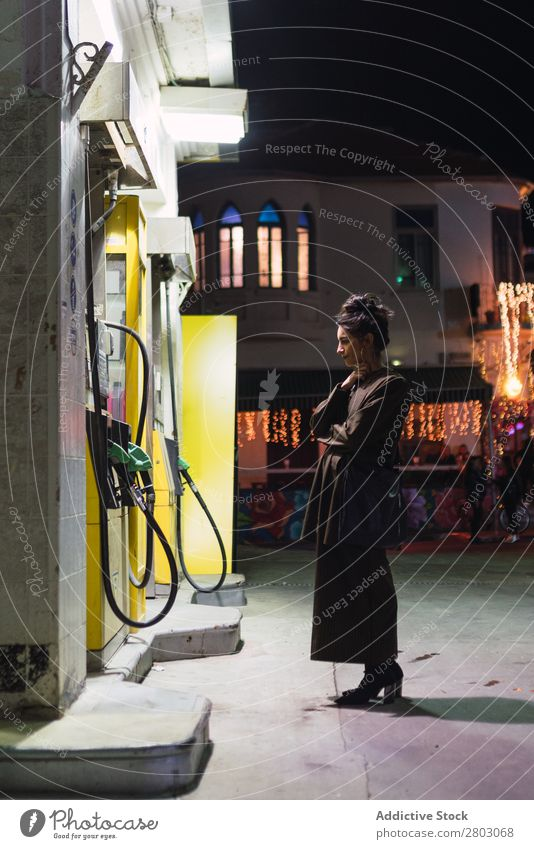 Attractive stylish lady on filling station Woman Style Hipster Petrol station Tel Aviv Israel Petrol pump Night