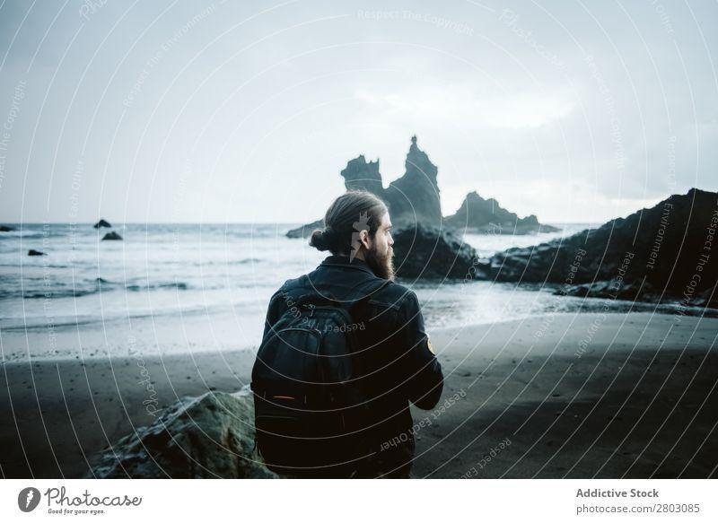 Bearded photographer standing near sea Man Ocean Vacation & Travel Coast Nature Looking away Waves Storm