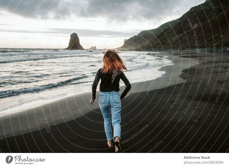 Barefoot female running near waving sea Woman Running Ocean Coast Storm Waves Clouds Sky Vacation & Travel Easygoing Style Hip & trendy Tourism Trip Lifestyle