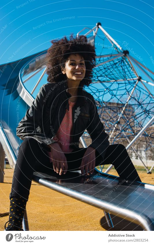 Woman with afro hair jumping down a slide. Adults African American Beautiful Black Farm Flag Girl Happy Hold Model Human being Stars states Wrap