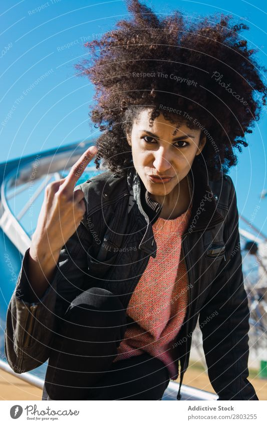 Woman with afro hair making insults. Adults Aggression Aggressive Anger attitude Bad Conceptual design Expression Fingers Gesture Girl Hand Human being Middle