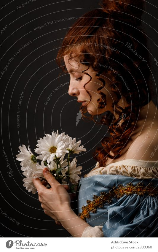 Beautiful woman in medieval clothing Woman Baroque Dress Hold Flower Carnival Renaissance Princess