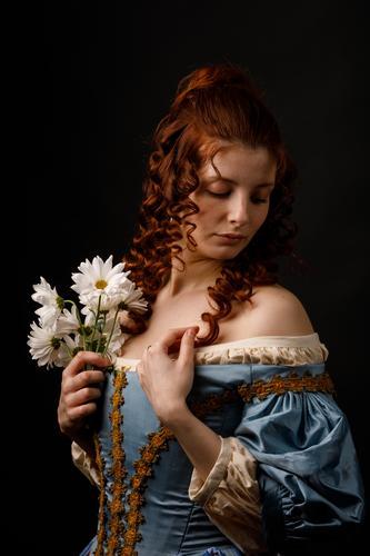 Beautiful woman in medieval clothing Woman Baroque Dress Hold Flower daisies Carnival Renaissance Princess Royal masquerade Fantasy Clothing aristocrat Fashion