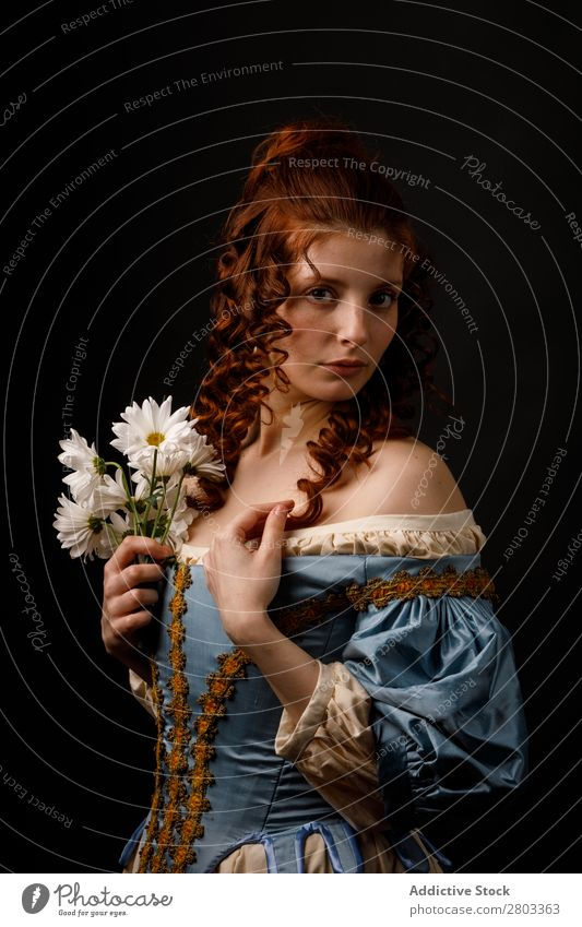 Beautiful woman in medieval clothing Woman Red-haired Baroque Dress Hold Flower daisies Carnival Renaissance Princess Royal masquerade Fantasy Clothing