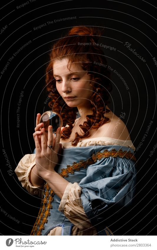 Baroque woman with glass ball Woman Red-haired Corkscrew Magic Ball Glass Dress
