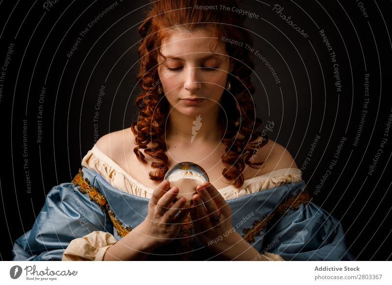 Baroque woman with glass ball Woman Red-haired Corkscrew Hold Magic Ball Glass